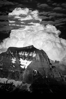 Thunderstorm Dwarfing Mountains